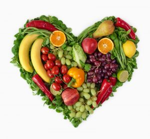 greens and fruits forming heart image